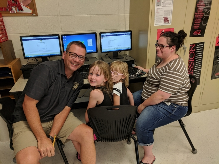 Mr. Ockenfels assisting a family with online registration.