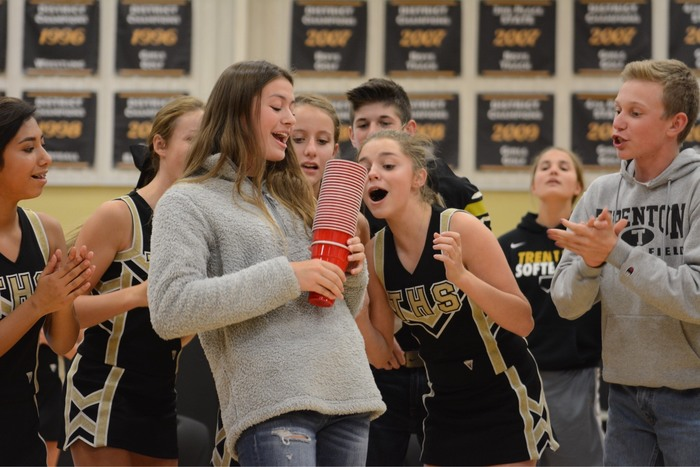Evy McCullough enjoying a game at a pep rally.